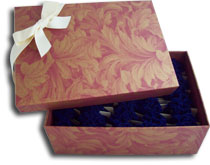 Custom keepsake box holds 50 pouches of unique party favors / wildflower seeds
